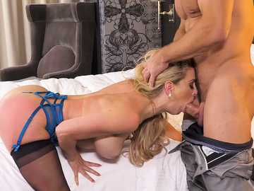 The buff man gets his dick wrapped up by the thick lips of tender brunette Cherie Deville