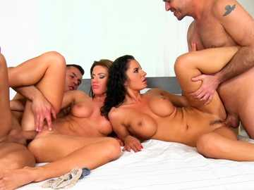 Busty sluts Lucy Bell and Tyra participate in hardcore foursome sex session