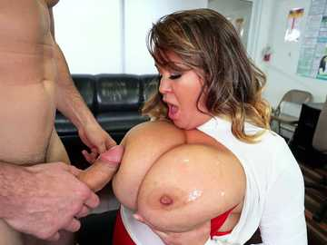Monster tits of cougar Brandy Talore find use titty fucking at the office