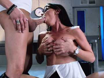 Special agent Brandy Aniston on her knees during a blowjob